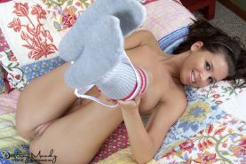 Destiny Moody takes off her skirt and shirt showing her nice titties and pink sl