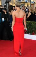 Kaley Cuoco busty wearing a strapless red dress at 21st Annual Screen Actors Gui