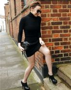 Kylie Minogue leggy in fishnets and mini skirt on street paparazzi pictures