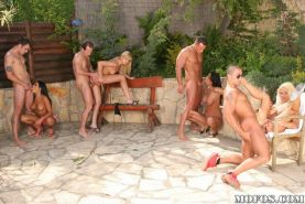 Naughty babes getting fucked in outside orgy sex party