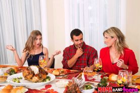 Cory Chase and Sydney Cole share a meat pole on Thanksgiving