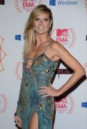 Heidi Klum braless showing huge cleavage in a low cut  high slit dress at MTV Eu