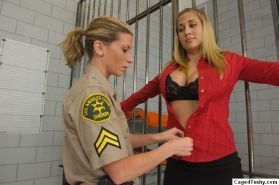 Huge titted blonde in the female prison