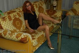 Mature redhead lady Claire spreadiing hips