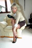 Mature Sue in brown stockings