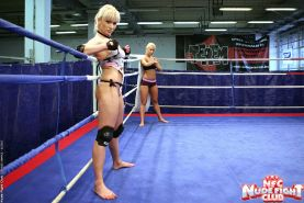 Watch these naked amazon fighters wrestle, struggle, suffer, kick and lick Nude