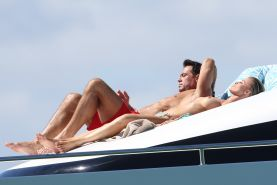 Joanna Krupa tanning topless at the yacht in Miami