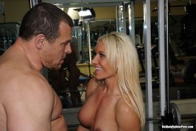 Naughty titted bodybuilder fucked hard by her trainer in the gym
