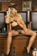Glamour Laurie Wallace in tan stockings posing with sexy hat