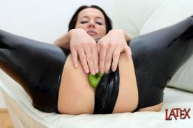 Latex Angel pushing apples into her asshole