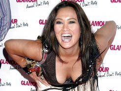 Tia Carrere downblouse paparazzi pictures and posing sexy in bikini
