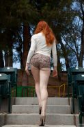 Pale redhead teen outdoors
