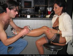Kinky lady B getting her feet licked by slave and gives footjob