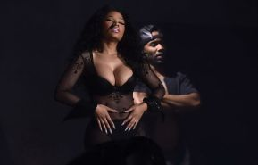 NIcki Minaj hot nipple slip in a fishnet jumpsuit