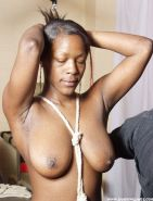Ebony fetish slavegirl Cookie in suspension bondage and extreme pain