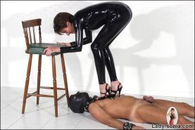 Latex catsuit domina tramples slaves cock in heels