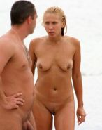 Nudist chick strips down naked at a public beach