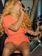Sexy black singer Lil Kim showing nice breasts