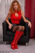 Redhead Lady Claire posing in pantyhose and boots