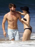 Miley Cyrus showing off her bikini body and getting her ass groped on a Hawaiian