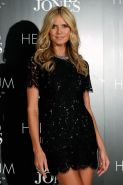 Heidi Klum leggy wearing a lace mini dress at her Intimates Collection launch in