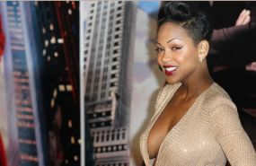 Meagan Good braless wearing gorgeous low cut  high slit dress at Anchorman 2:The