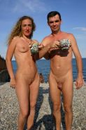 Teen nudists expose themselves at a public beach