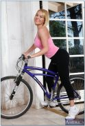 Athletic porn star Krissy Lynn rides his cock after riding her bike