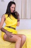 Leggy brunette in her yellow dress and retro lingerie