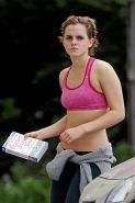 Emma Watson exposing sexy body and nice tits in sports bra on street
