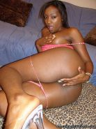 Ebony teen pimps out in pink lingerie for a black cock fucking