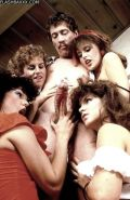 John Holmes gets blown by four 1980s babes