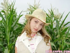 Teen with braces having some fun on a cornfield