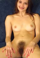Beautiful redhead with hairy pussy