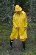 Sexy girl with rubber boots and yellow rainwear