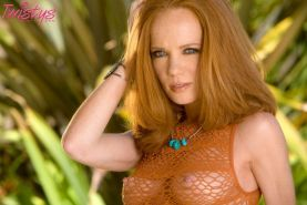 Redhead babe Heather Carolin showing off her body outdoors