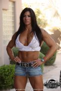 Female bodybuilder with big muscles and huge clit