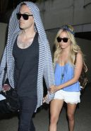 Ashley Tisdale wearing skimpy top and tiny shorts at LAX airport in LA