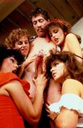 Big John Holmes gets sucked by four hungry babes