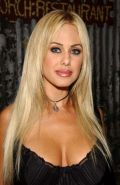 Shauna Sand shows off her hot body in skintight dresses
