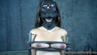 Sister Dee bound in metal and plastic with mask her pussy spread