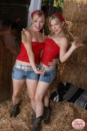 Pretty teen twins with small tits doing hot striptease on a farm