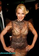 Kylie Minogue showing her tits and posing in see thru dress