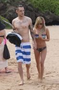 Ashley Tisdale wearing skimpy colorful bikini on the beach in Hawaii