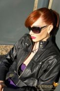 Latina Shemale Mariana Cordoba in sunglasses and high boots posing on a bench