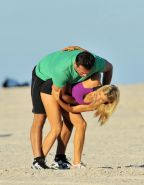 Joanna Krupa in tight shorts and sport bra at Miami Beach getting groped or just