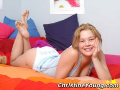 Innocent looking blonde Christine Young teasing on her bed