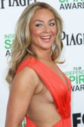 Elisabeth Rohm braless showing huge cleavage in a side-transparent orange dress