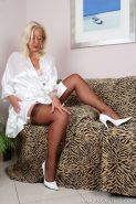 Amazing Astrid shows her legs in stockings