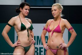 Feisty Blond takes on Bodacious Brunette in nude wrestling.